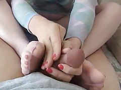 Footjob from the girl in pantyhose tubes