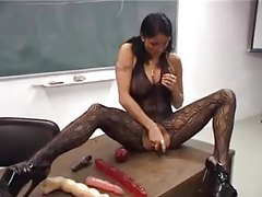 Cute pigtailed girl masturbates for audience in class tubes