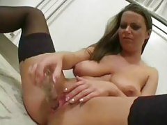 Voluptuous chick in stockings toys pussy in kitchen tubes