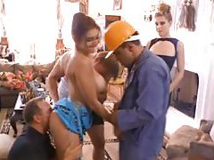 Two hot girls on their knees suck construction workers tubes