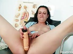 Hairy mature pussy banged by a toy tubes
