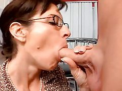 Glass wearing housewife sucks younger mans cock tubes