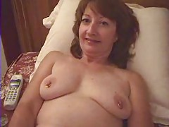 Horny mature babe slides her phone in her pussy tubes