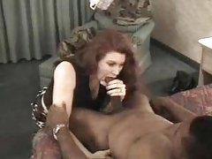 Elegant redhead amateur sucks on thick black dick tubes