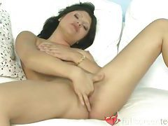 Sexy girl with perky tits masturbates with her dildo tubes