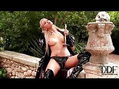 Kinky minx in latex fucks the hilt of a sword tubes