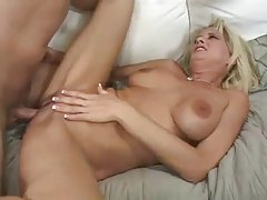 Milf with sexy fake tits loves that dick tubes