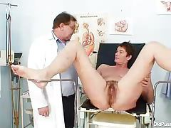 Hairy old babe and her doctor have an exam tubes