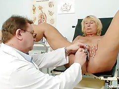 Doctor does a thorough exam with blonde mature tubes