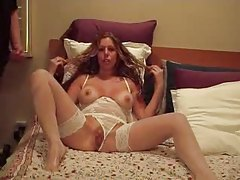 Blonde milf in sexy lingerie spreads her pussy then sucks cock tubes