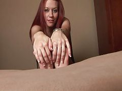 Smiley redhead rubs lotion on her cute feet tubes