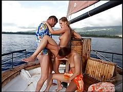 Luscious hotties enjoy sharing cock on a boat tubes
