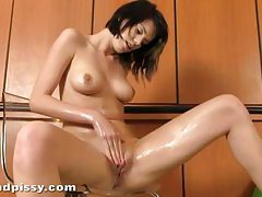 Slender yet busty Angela rubs her wet pissing pussy tubes
