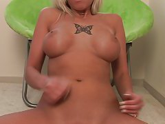 Vixen with huge melons pretends to stroke cock tubes