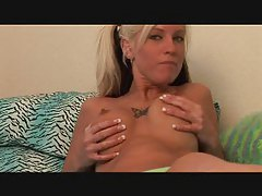 Busty blonde with tattoos plays with her melons tubes