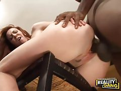 Smiley redhead rides enormous big black cock tubes