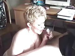 Mature wife on her knees sucks dick tubes