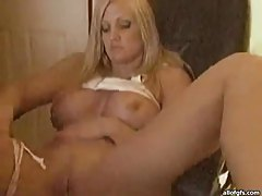 Busty blonde babe exposes her goods on a webcam tubes
