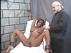 Bound ebony babe gets her pussy clipped open tubes