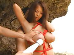 Fondling huge tits Japanese girl on beach tubes