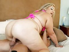 Fat girl in pink bikini top sits on cock tubes