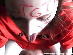 Horny teen with face paint sucking on a wang tubes
