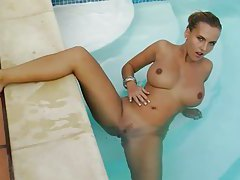 Stunning big tits on curvy girl hanging poolside tubes