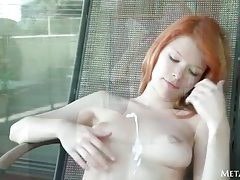 Redhead rubs sunscreen into her gorgeous body tubes