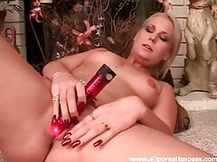 Sensual blonde minx with perky tits fucking red dildo tubes