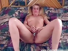 Amateur blonde with pigtails slides dildo in her moist snatch tubes