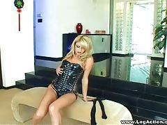 Golden haired goddess in latex corset teasing with stockings tubes
