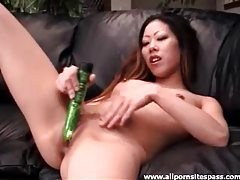 Petite Asian hottie uses her new green dildo tubes