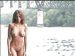 Dirty girl washes her nude body in the river tubes