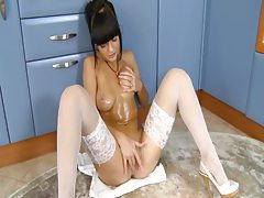 Oiled up babe white fishnet stocking masturbation tubes