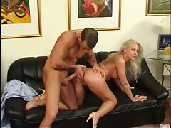 Elegant blonde with luscious long legs pumped from behind tubes