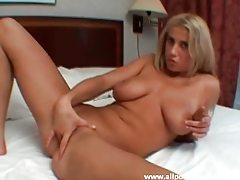 Golden haired hottie with perfect jugs fucking her purple toy tubes