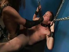 Man in bondage takes strapon cock in ass tubes