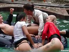 Clothed lesbian orgy in the pool tubes