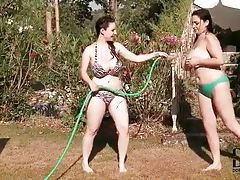 Busty beauties playing with hose outdoors tubes