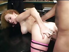 Redhead has sex in pink seamed stockings and heels tubes