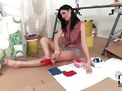 Kinky brunette painting the bottom of her feet tubes