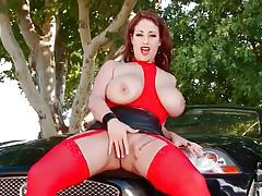 Incredibly busty redhead hottie playing on the car tubes
