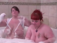 Two big babes getting wet in the bathtub tubes