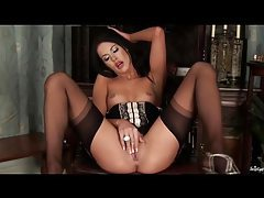Stunning brunette in stockings fingers her pussy hard tubes