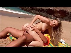 Blonde babe enjoying a fat cock on the beach tubes