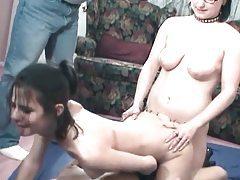 Three pretty lesbian girls enjoy using a strapon tubes