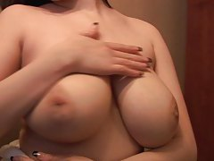She rubs lotion into her gorgeous big tits tubes