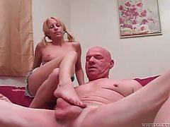 Horny pigtailed blonde cutie massaging older mans cock with her feet tubes