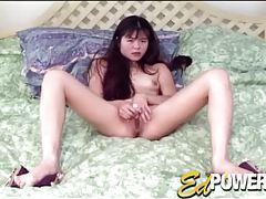 Cute masturbating Asian girl with a vibrator tubes