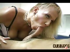 Blonde hottie in corset stroking cock with her mouth tubes